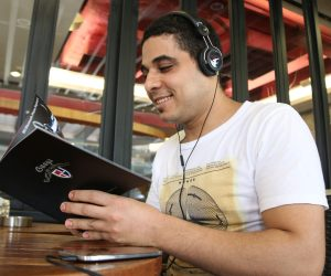 practice listening English online about read in library
